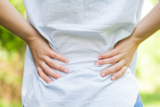 Pregnant woman with lower back pain stock photo
