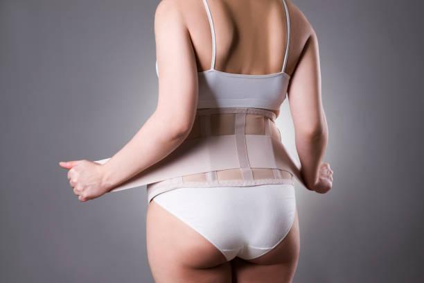 整形外科のサポート ベルト、妊娠包帯と妊娠中の女性 ストックフォト