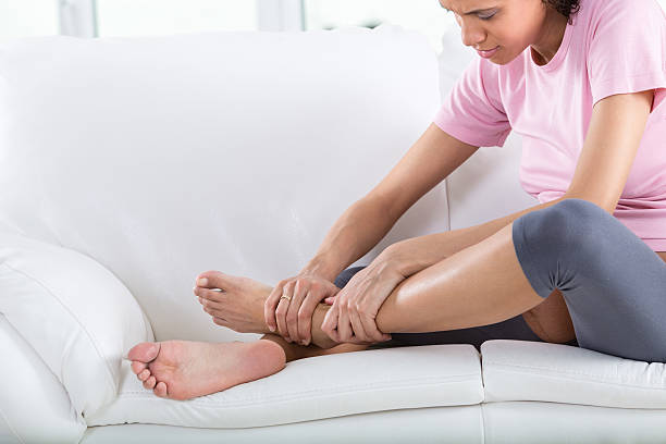 Pregnant woman with swollen feet Pregnant woman with swollen feet and leg pain. human leg stock pictures, royalty-free photos & images