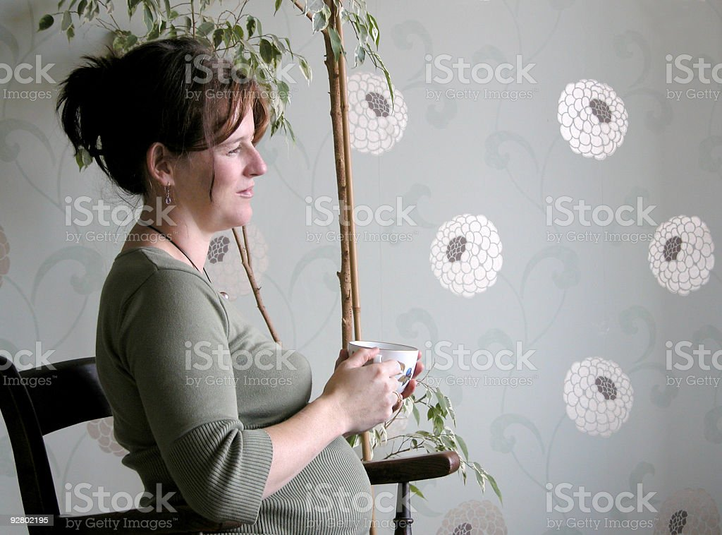 Pregnant woman with teacup stock photo