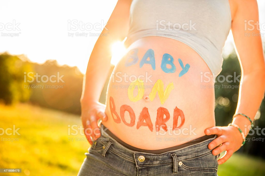 Pregnant Woman With Text On Belly stock photo