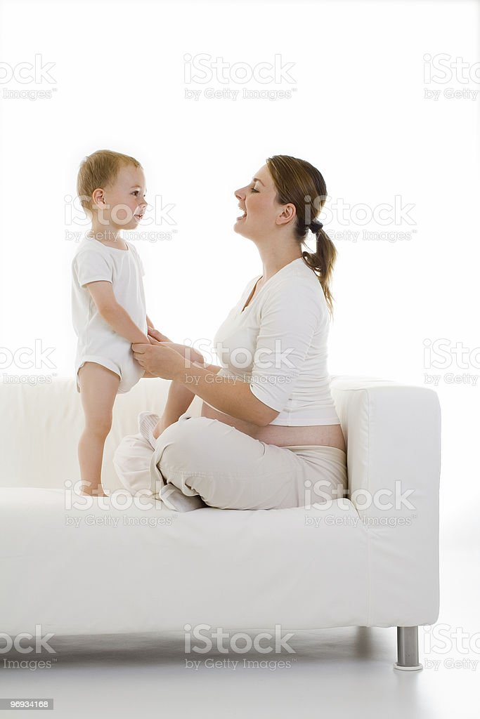 Pregnant woman with toddler royalty-free stock photo