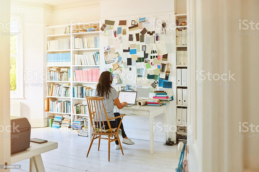 Pregnant woman working at home stock photo