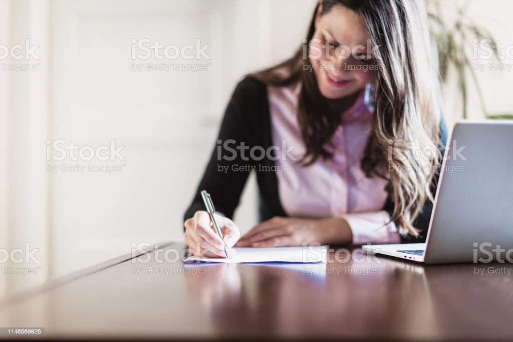 Businesswoman writing in the office