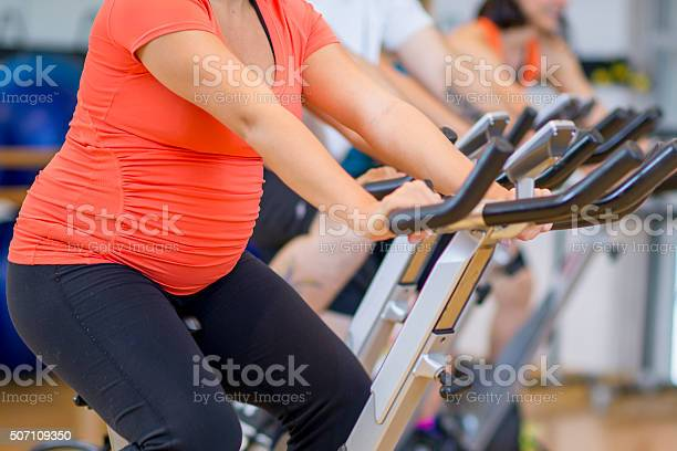 Pregnant woman working out on a bike at the gym picture id507109350?b=1&k=6&m=507109350&s=612x612&h=ged5w3tftltcjrp5iwewce8cbhwirx0gxqyu8ql4blg=