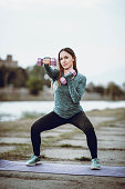 Pregnant Woman Working Out With Dumbbells Near River