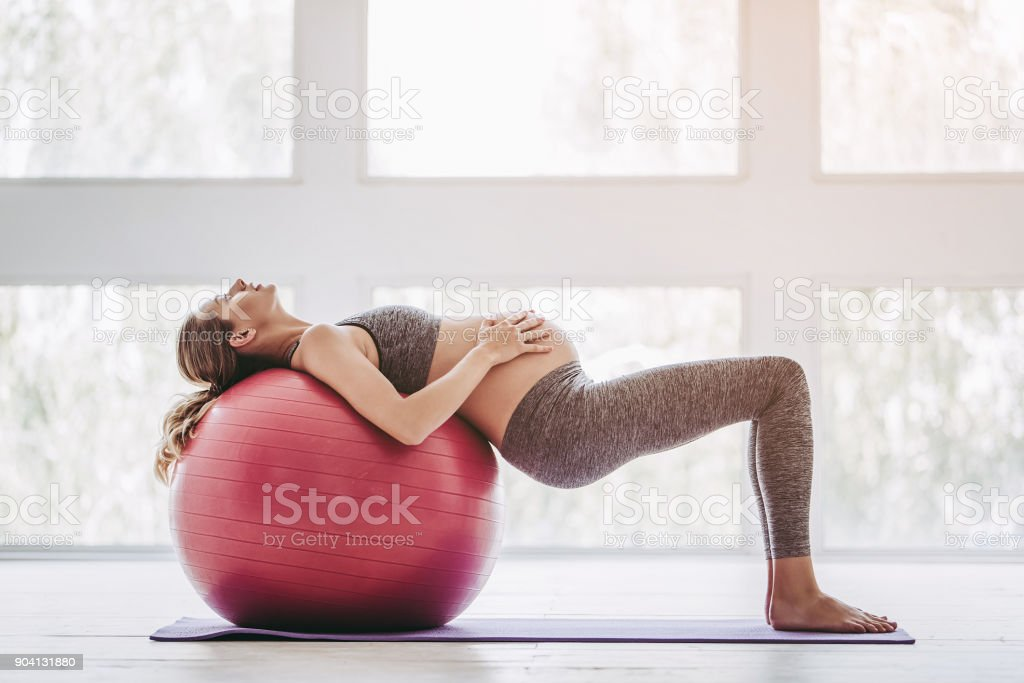 Pregnant woman workout. stock photo