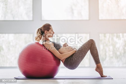 istock Pregnant woman workout. 904131904