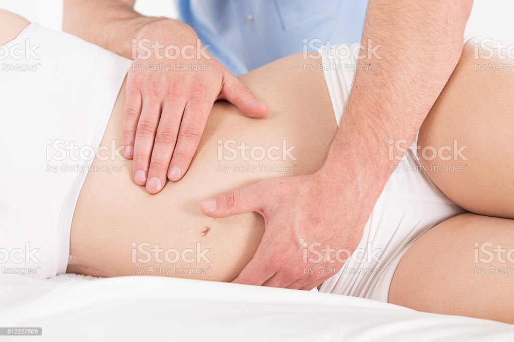 Pregnant woman's belly stock photo