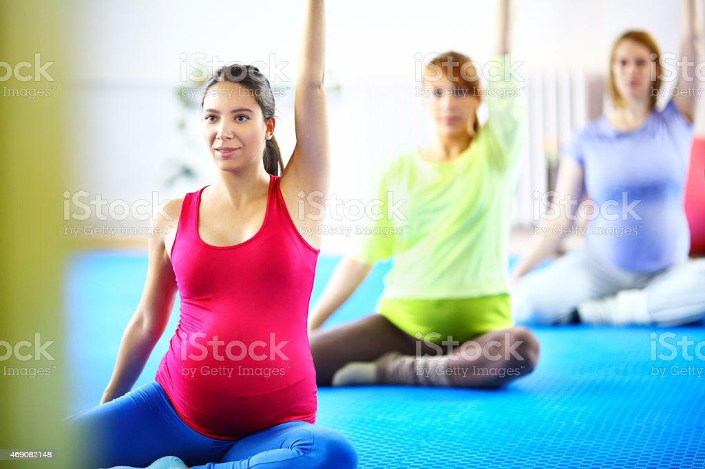 Pregnant women exercising. stock photo