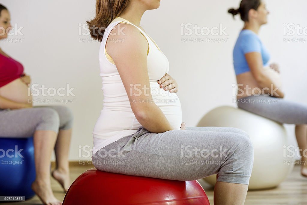 Pregnant women exercising stock photo