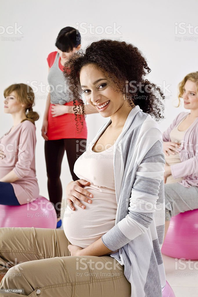 Pregnant women on gym balls stock photo