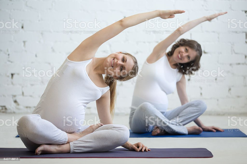 Pregnant Young Women Doing Prenatal Yoga Bending In Easy Pose Stock Photo Download Image Now Istock