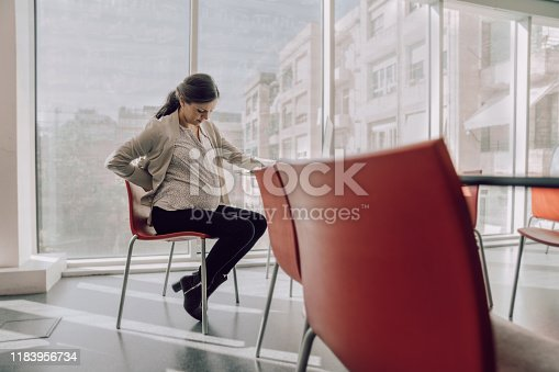 Pregnat woman working at the office