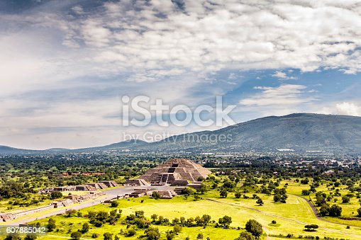 """Pre-Hispanic City of Teotihuacan. Mexico. The holy city of Teotihuacan is situated about 30 miles (50 kilometers) northeast of Mexico City. No one knows who did it but it was built aprox 2,100 years ago. The main and largest monuments are the Temple of Quetzalcoatl and the Pyramids of the Sun and the Moon. Those monuments were laid out on geometric and symbolic principles.  The name of Teotihuacan was given to it by the Aztecs and means """"the place where the gods were created."""""""