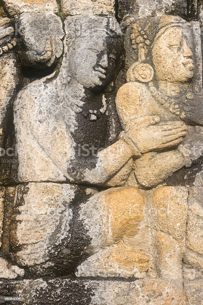 Prehistoric buddhist temple stone-carvings in Indonesia royalty-free stock photo