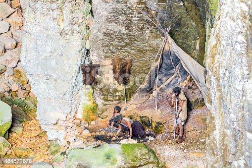 841481956istockphoto Prehistoric caveman family camp in cave of la Balme France 484572676