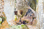 Prehistoric caveman family camp in cave of la Balme France