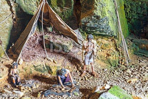 841481956istockphoto Prehistoric caveman family camp in cave of la Balme France 484731940
