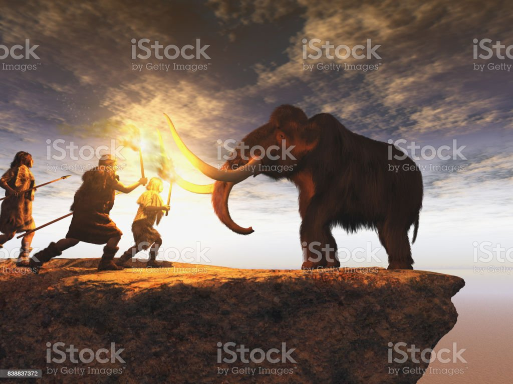 Prehistoric men hunting a young mammoth stock photo