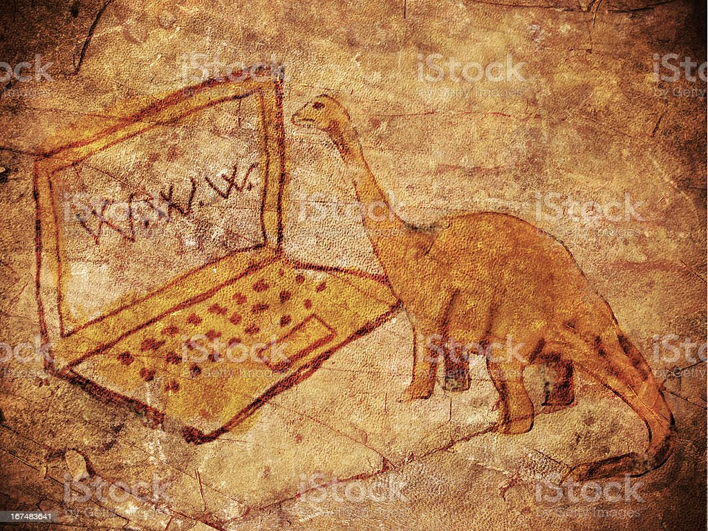 prehistoric petroglyph with computer and dinosaur stock photo