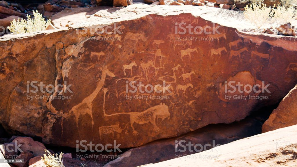 Prehistoric petroglyphs at Twyfelfontein archaeological site, Namibia stock photo