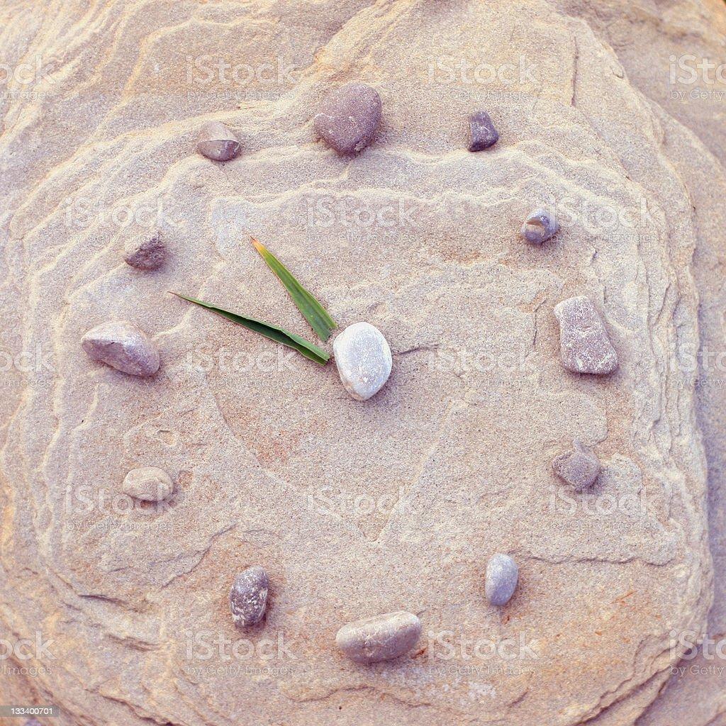Prehistoric 'Rock' Clock - Technology Concept royalty-free stock photo