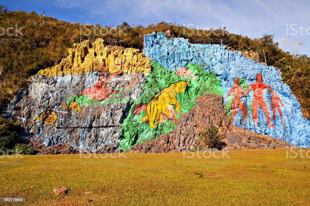 Prehistorical mural (Mirador) in Valle de Vinales, Cuba stock photo