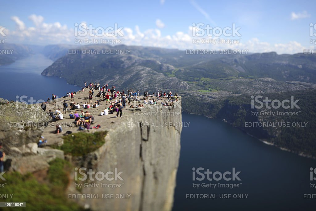 Preikestolen rock cliff with tourist looking at fjord stock photo