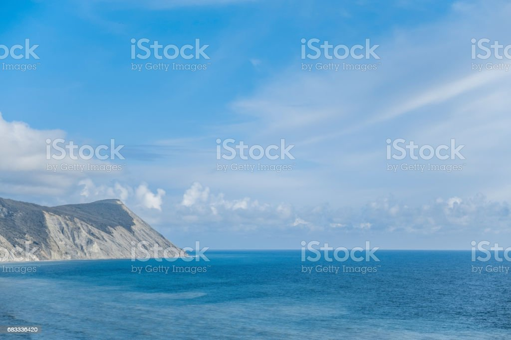 Prekrasnye green mountains next to the blue sea, the view from the top landscape royalty-free stock photo