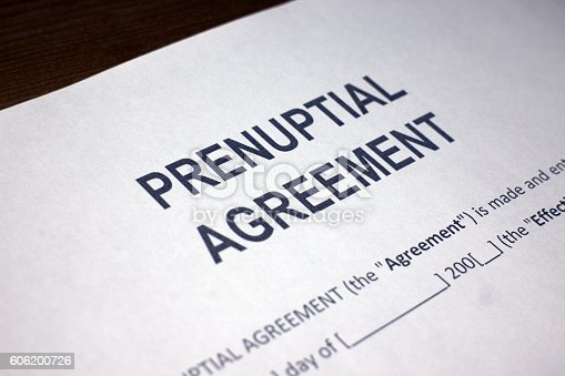Someone filling out Prenuptial Agreement.