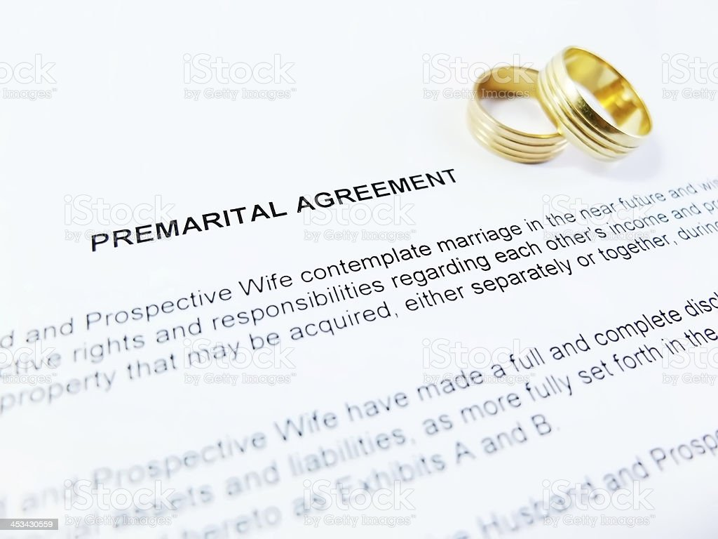 Premarital Agreement with Wedding Rings close up