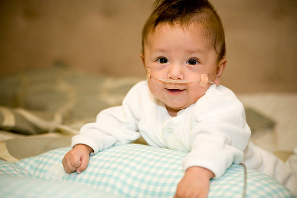 Premature Baby Boy Baby boy born 3 months premature. Here at 7 months of age.View More this model: medical oxygen equipment stock pictures, royalty-free photos & images