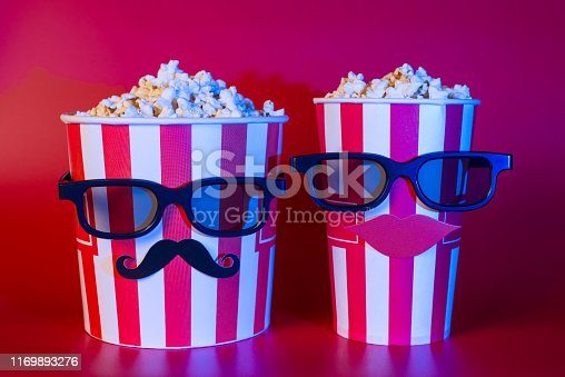 istock Premiere night blockbuster trailer advert concept. Photo of two best buddies enjoying nice interesting exciting comedy on tv isolated bright color background 1169893276
