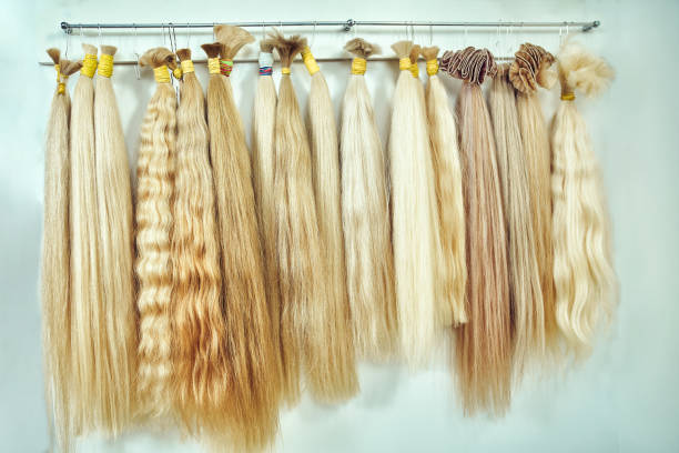 Premium hair extension palette with color samples from blonde to stock photo