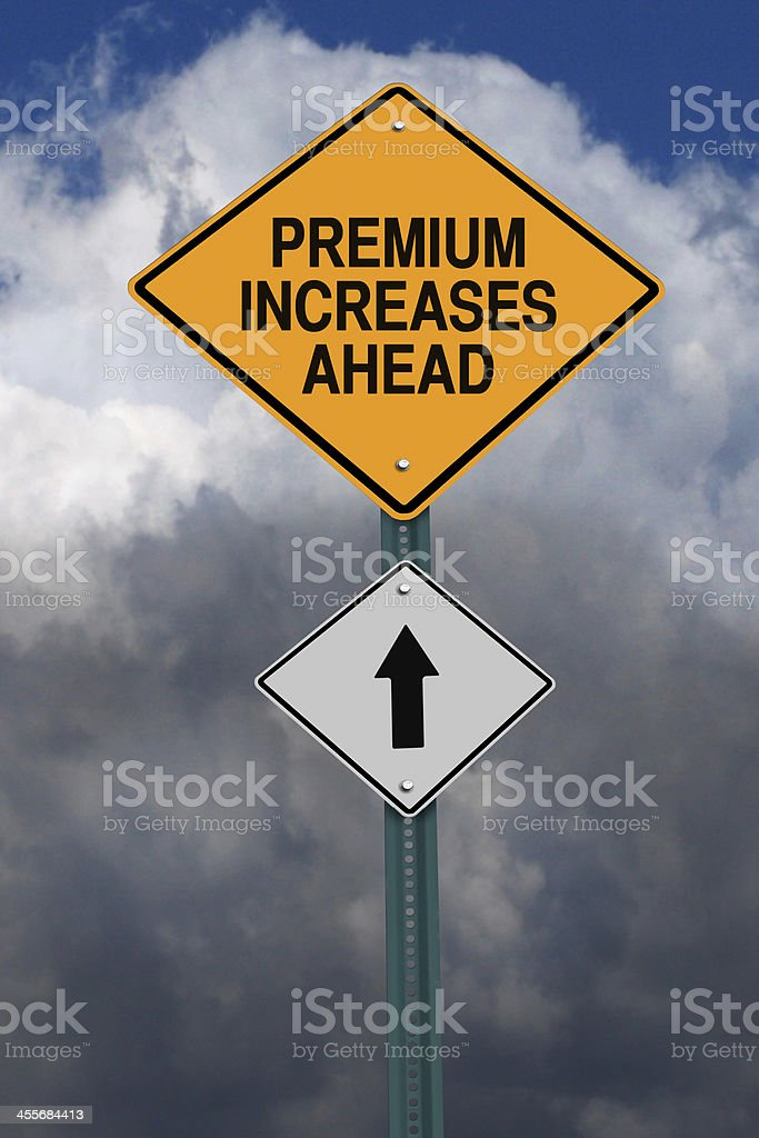 premium increases ahead roadsign stock photo