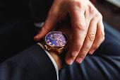 istock Premium men's watch on hand close up 1065329058