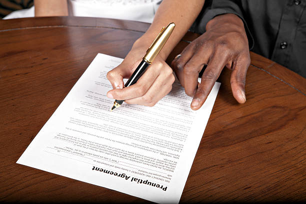 prenuptial agreement - jodijacobson stock pictures, royalty-free photos & images