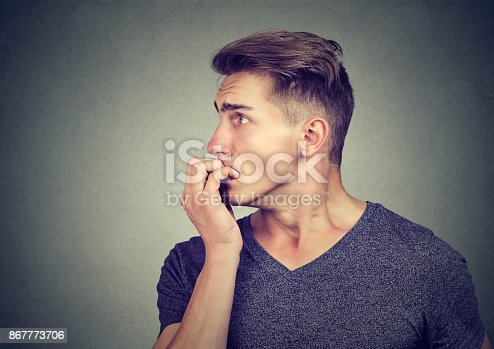 istock Preoccupied anxious man biting his fingernails looking to the side 867773706