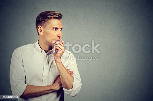 istock Preoccupied anxious young man 599886490