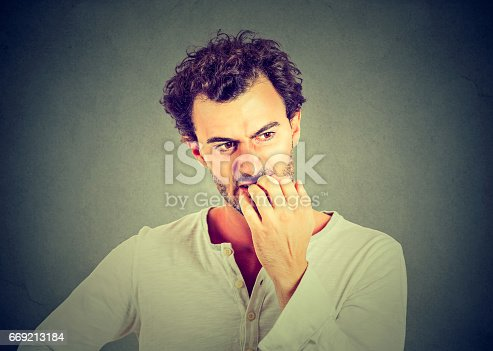 istock Preoccupied anxious young man 669213184
