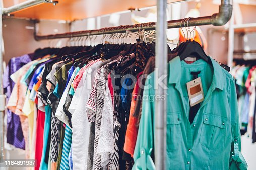 Shot of clothes hanging on a rack in a thrift store