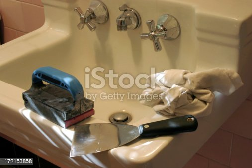 Tools on sink in bathroom for paint preparation and improvement