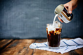 Prepairing iced latte on wooden table