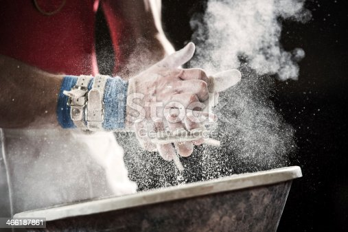 Human gymnastic hands covered with chalk powder.