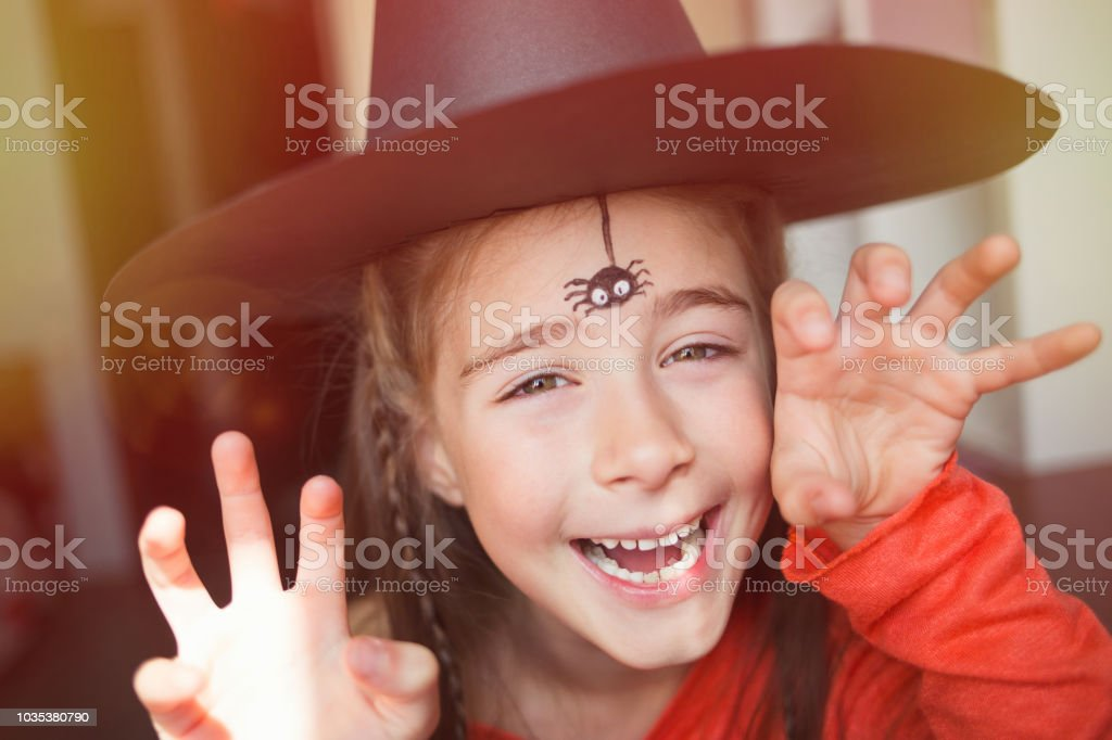 Preparation For Halloween Child In A Witch Outfit Doing Face