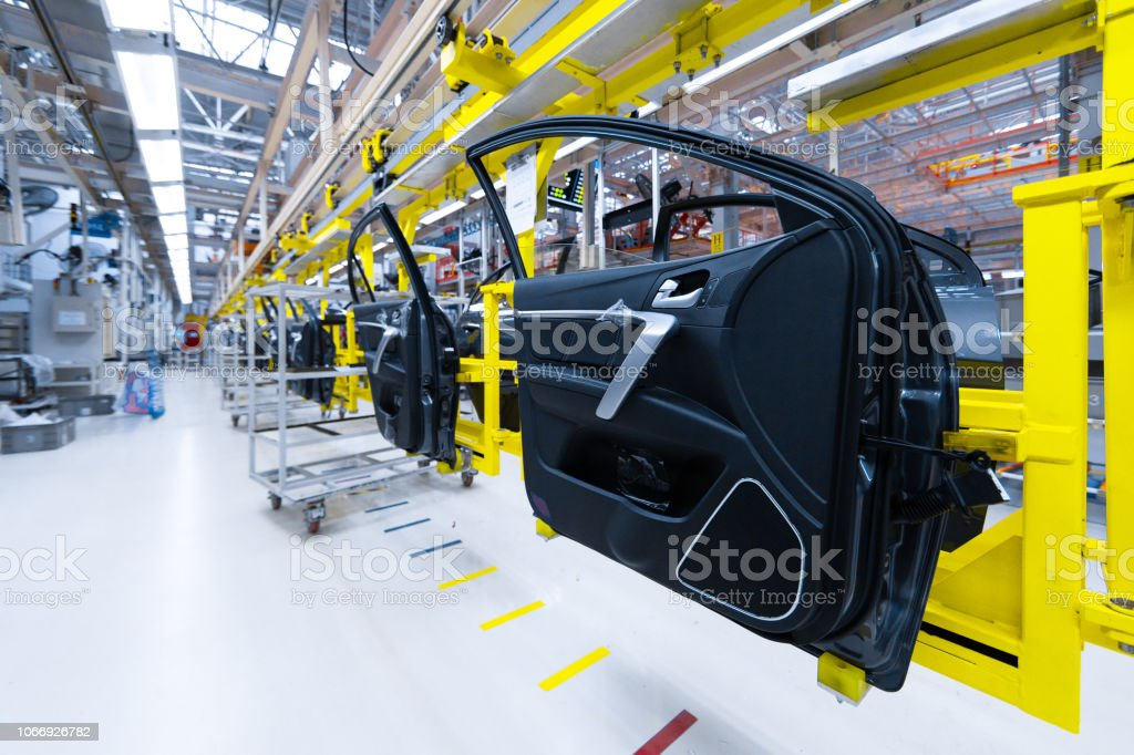 Preparation of doors for installation in car factory. Plant for...