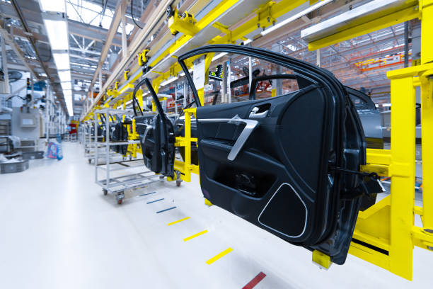 Preparation for installation of body part in car factory. door from car on production line stock photo