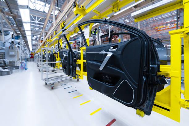 preparation for installation of body part in car factory. door from car on production line - taśma produkcyjna zdjęcia i obrazy z banku zdjęć