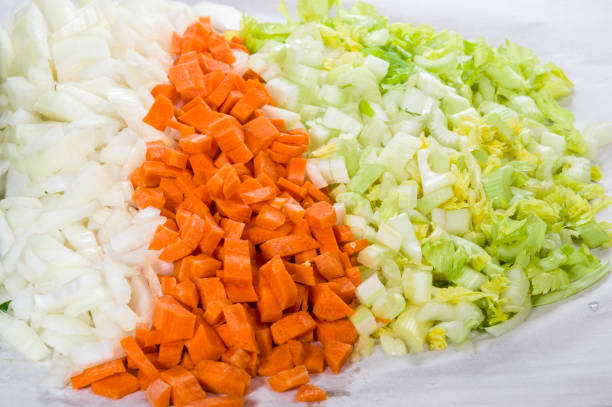 Preparation for soup with carrots, onions and celery stock photo